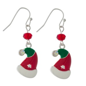 "Dainty silver tone earrings with a Christmas hat and a bead accent. Approximately 1"" in length."