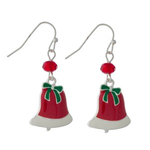 "Dainty silver tone earrings with a Christmas bell and a bead accent. Approximately 1"" in length."