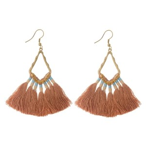 "Burnished gold tone fishhook earrings with tan, thread, fan tassels and rhinestone accents. Approximately 2.5"" in length."