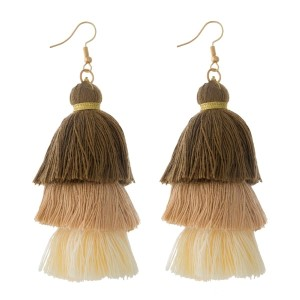 "Gold tone fishhook earrings with brown to ivory, ombre, tiered tassels. Approximately 3"" in length."