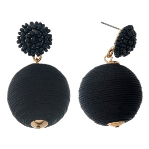 """Gold tone stud earrings with a thread wrapped bead accent. Approximately 1.5"""" in length."""