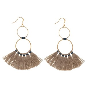 """Dainty gold tone fishhook earrings with two open circle shapes and a fan tassel. Approximately 3"""" in length."""