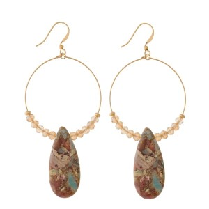 """Gold tone fishhook earrings with a beaded, open circle shape and a natural stone. Approximately 3.25"""" in length."""