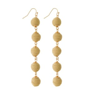 "Gold tone fishhook earrings with five thread wrapped beads. Approximately 4"" in length."
