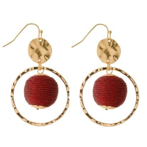 "Gold tone fishhook earrings with an open circle shape and a thread wrapped bead. Approximately 2.25"" in length."