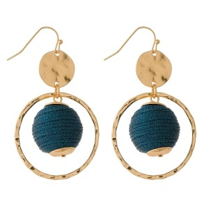 """Gold tone fishhook earrings with an open circle shape and a thread wrapped bead. Approximately 2.25"""" in length."""