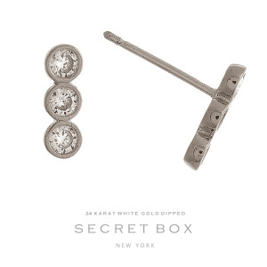 """Secret Box 24 karat white gold over brass stud earrings with three clear rhinestones. Approximately 1/2"""" in length."""