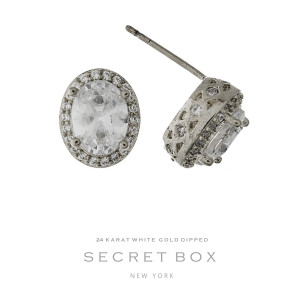 """Secret Box 24 karat white gold dipped over brass oval rhinestone stud earrings. Approximately 1/3"""" in length. Sold in a gift box."""
