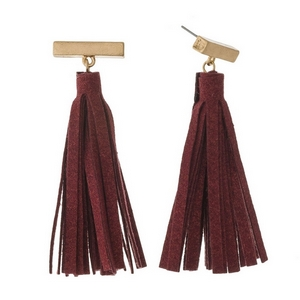 """Gold tone, bar post earrings with a faux leather tassel. Approximately 2.5"""" in length."""