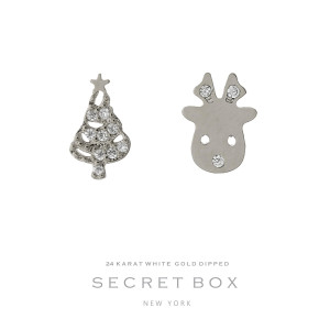 "Secret Box 24 karat white gold over brass reindeer and Christmas tree stud earrings. Approximately 1/4"" in size."