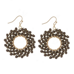 """Gold tone fishhook earrings with a beaded, open circle shape. Approximately 2"""" in length."""