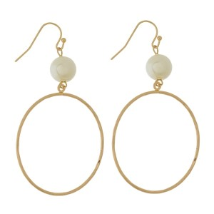 """Fishhook earrings with a hammered circle shape and a pearl bead. Approximately 3"""" in length."""