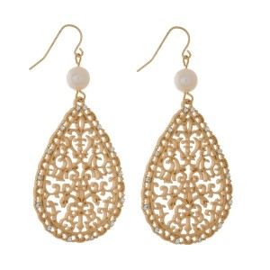 """Matte metal, fishhook earrings with a freshwater pearl bead, clear rhinestone accents, and a teardrop shape. Approximately 2.5"""" in length."""