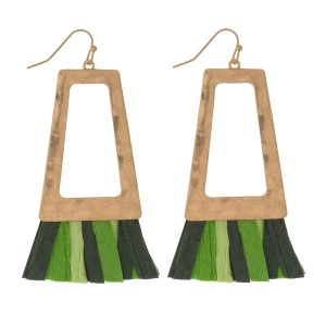 """Burnished gold tone fishhook earrings with an open square shape and raffia tassels. Approximately 3"""" in length."""