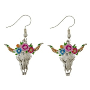 "Silver tone fishhook earrings with a steer head skull and flower accents. Approximately 1"" in length."