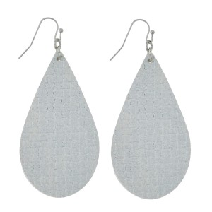 "Faux leather earrings with a teardrop shape and a metallic, basketweave look. Approximately 2.5"" in length."