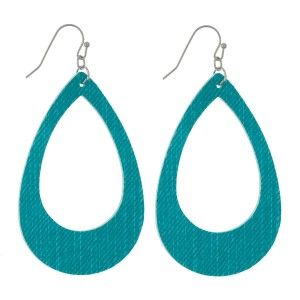 "Faux leather earrings with a cutout teardrop shape and a denim look. Approximately 2.5"" in length."