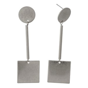 "Burnished metal, stud earrings with circle and square shapes. Approximately 3"" in length."