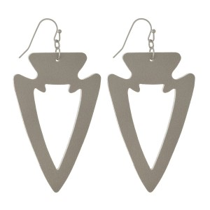 "Silver tone fishhook earrings with faux leather, cutout arrowheads. Approximately 3"" in length."