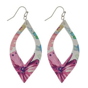 """Silver tone fishhook earrings with a faux leather, cutout oval shape with a floral pattern. Approximately 2.25"""" in length."""