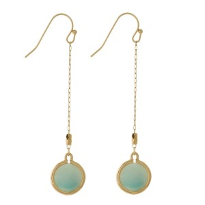"Dainty gold tone fishhook earrings with a small, faceted stone. Approximately 2.5"" in length."