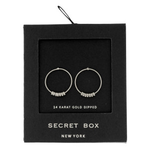 """Secret Box 24 karat white gold dipped over brass circle stud earrings. Approximately 3/4"""" in diameter. Sold in a gift box."""