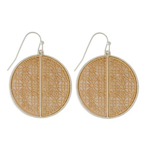 """Fishhook earrings with a filigree, circle shape and a mother of pearl backing. Approximately 1.5"""" in length."""