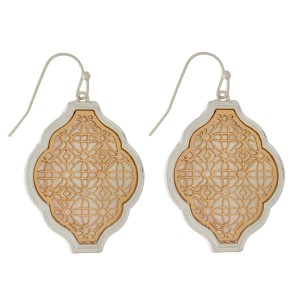 """Fishhook earrings with a filigree, moroccan shape and a mother of pearl backing. Approximately 2"""" in length."""