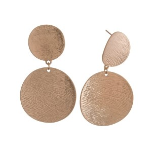 """Metal, statement earrings with two circle shapes and a brushed texture. Approximately 2.25"""" in length."""