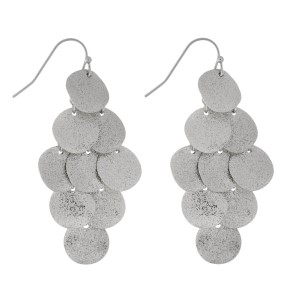 """Metal, fishhook earrings with circle shapes. Approximately 2"""" in length."""
