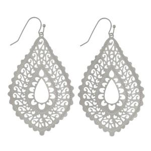 """Fishhook earrings with a filigree, metal, teardrop shape. Approximately 2"""" in length."""