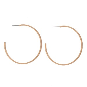 "Plated brass, hoop earrings with a matte finish. Approximately 2"" in length."