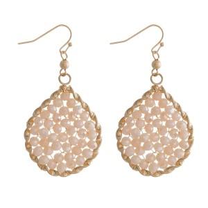 """Metal, fishhook earrings with a mint beaded, teardrop shape. Approximately 2"""" in length."""