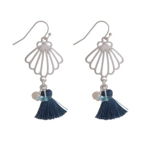 "Dainty fishhook earrings with a cutout seashell and a tassel accent. Approximately 2"" in length."