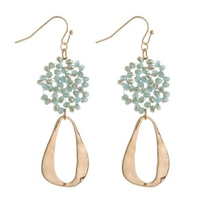 """Gold tone fishhook earrings with a beaded circle and an open circle shape. Approximately 2.5"""" in length."""