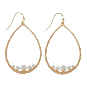 """Fishhook earrings with a hammered teardrop shape and a pearl bead. Approximately 2.5"""" in length."""