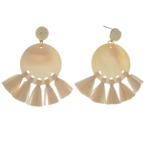 """Gold tone, post earring with natural shell circle accented with raffia tassels. Approximately 3"""" in length."""