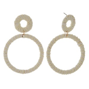 """Gold tone, post earring with circle pendant wrapped in raffia. Approximately 3"""" in length."""