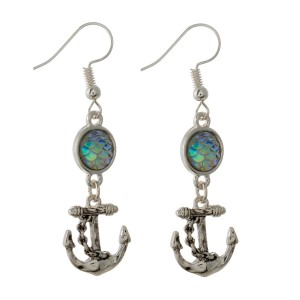 """Silver tone, fishhook earring with sea life charm. Approximately 1.5"""" in length."""