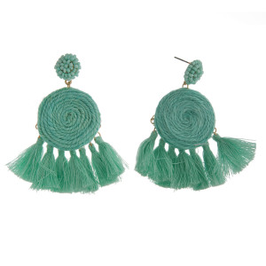 """Statement, post style earring with glass beads, raffia cord, and soft tassel detail. Approximately 3"""" in length."""