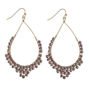 """Gold tone drop earring accented with faceted beads. Approximately 2"""" in length."""
