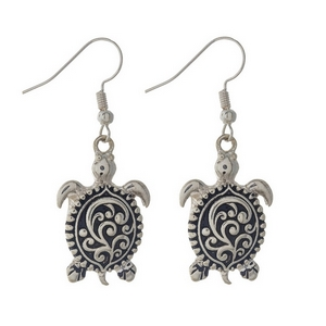 "1 1/4"" Silver tone sea life earrings featuring beautiful sea turtles in a filigree design.."
