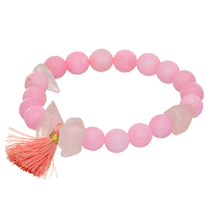 Stretch bracelet featuring pink beads and natural stones with a tassel accent.