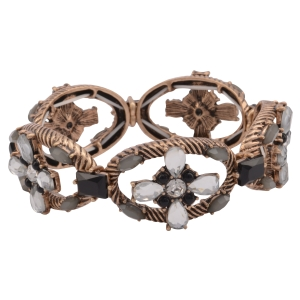Burnished gold tone stretch bracelet featuring a clear rhinestone and black cabochon floral design.