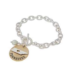 """Matte two tone toggle state bracelet with a """"TENNESSEE"""" charm and a faux pearl accent. Approximately 8"""" in length."""