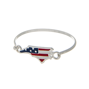 Silver tone latch bangle bracelet with an American flag inspired state of North Carolina focal.