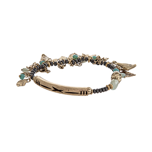 Turquoise and gray beaded stretch bracelet with dangling burnished gold tone leaves.