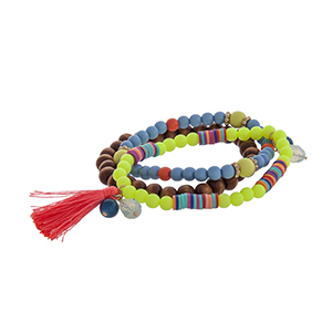 Triple strand stretch bracelet with brown wood, neon yellow, and blue beads, multicolored disk, and a hot pink tassel.