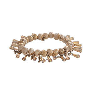 Champagne stretch bracelet with dangling beads and gold tone chains.