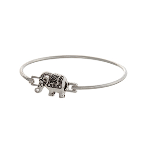 Silver tone latch bangle bracelet displaying an elephant focal.